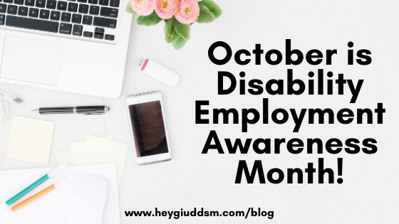 "Image is of a white desk with a MacBook laptop, several pens, notebooks, tech accessories, an iPhone and pink flowers with ""October is Disability Employment Awareness Month!"" written in black."