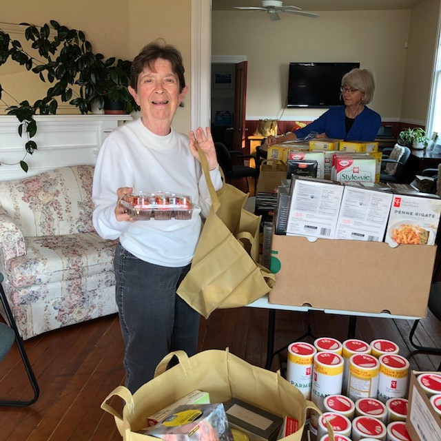 SVSS Volunteer organizing gift baskets for clients