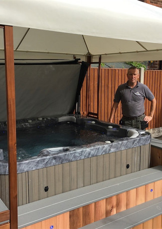 Our Superior range Dream 6 seater spa in Storm cloud grey, Cedar bar and steps with LED lighting.