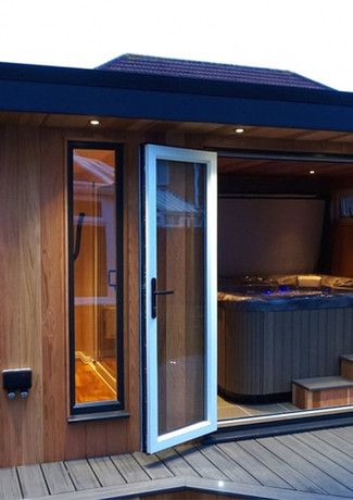 Our very popular Pluto 5 seater hottub looking amazing in one of our bespoke gardenrooms.