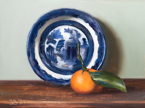 Blue Willow Saucer and Clementine