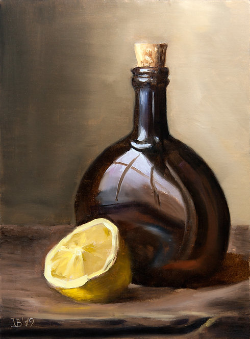 Glass Bottle and Lemon