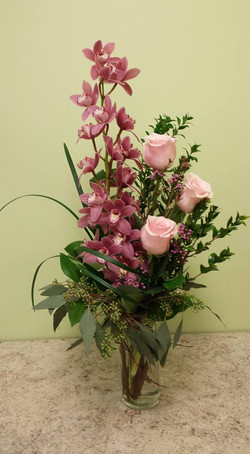 orchid pink and roses arrangement