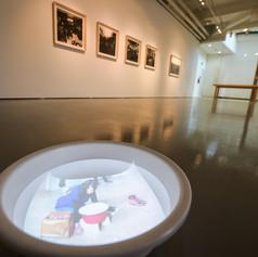 Installation view: anGie Seah, Scream Ensemble, video installation; Sufian Samsiyar, Retrospectare Santa Cruz, photographic prints. The Art Incubator 6: Residency as method, Institute of Contemporary Arts Singapore, 2015.