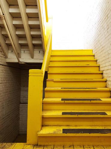 Original Yellow Stairs Leading To Upstairs Lofts