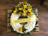 Based open wreath with a yellow corsage