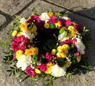 Pink, white and yellow open wreath