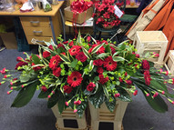 Mixed red flower top spray