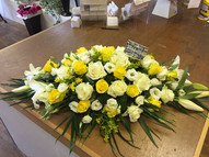 Yellow roses, white roses and lily top spray