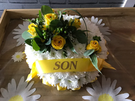 Based posy with yellow corsage and ribbon