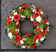 Orange, green and white open wreath