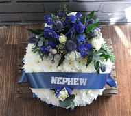 Based posy with blue corsage