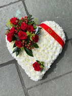 White based heart with a red corsage