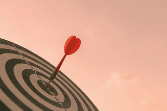 Red dart target arrow hitting on bullseye with,Target marketing and business success conce