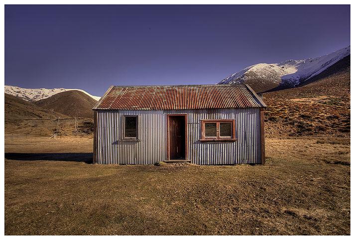 New Zealand_Crib_Hut_Snow_Hills_Old Building_Rusty Iron