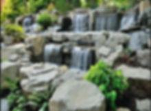 stone waterfall and bridge