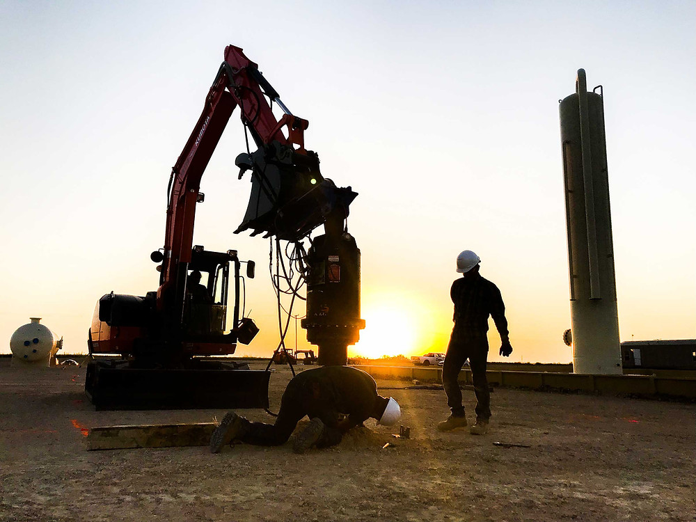 Screw piles being installed at an oil and gas facility in Texas.