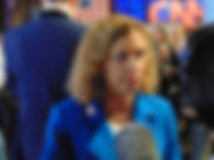 Adam Klasfeld photograph of DNC chair Debbie Wasserman Schultz reporting