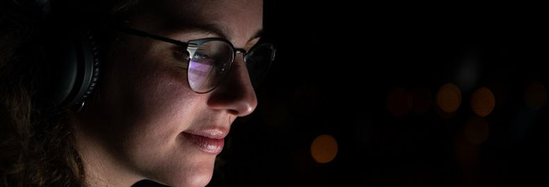 woman-with-glasses-and-wireless-headphon