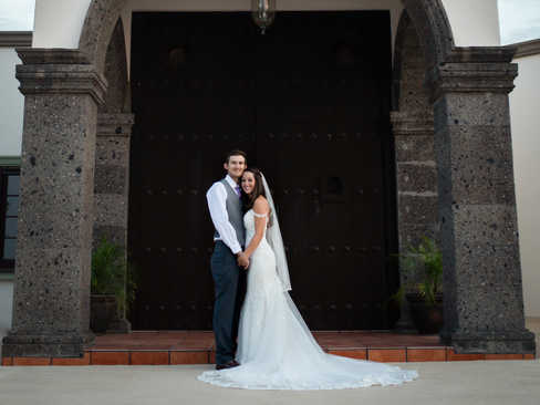 Bride and groom in front of bell tower