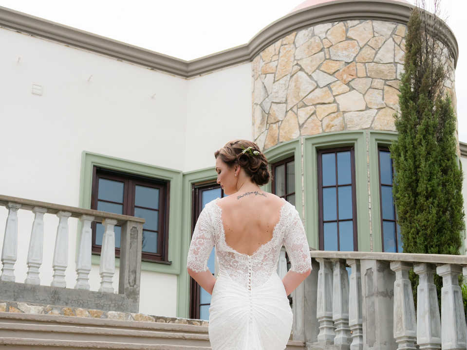 Bride on spiral staircase at Stoney Ridge Villa