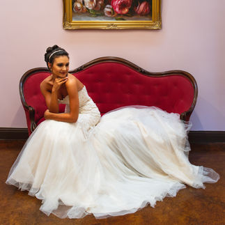 Bride on red vintage couch