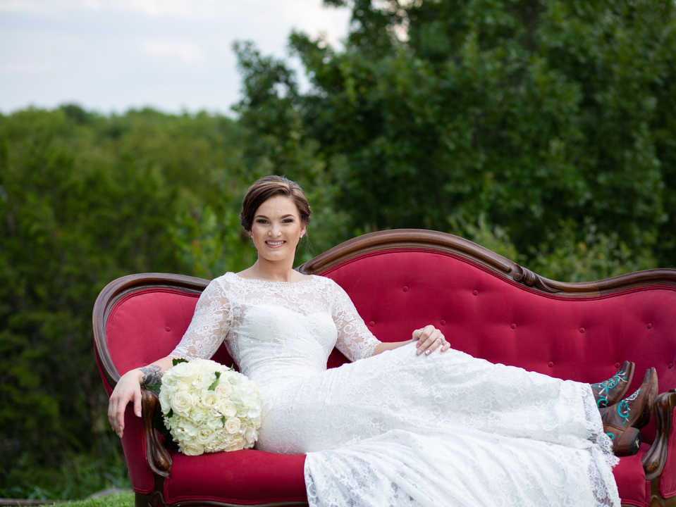 Bride on red couch outside