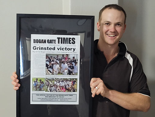 andrew with front page.jpg