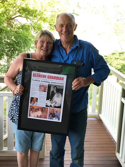 nathan's parents with front page.jpg