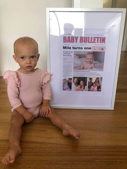 Miller with baby Bulletin.jpg