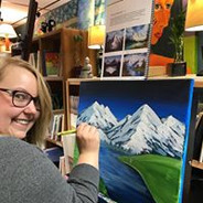 MBodied website woman painting mountains