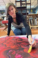 Michelle painting on floor cropped.jpg