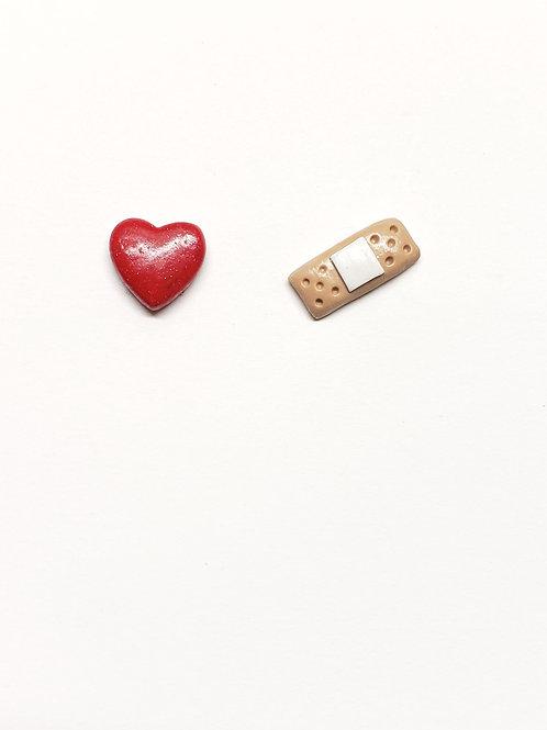 Bandaged Kiss Stud Earrings