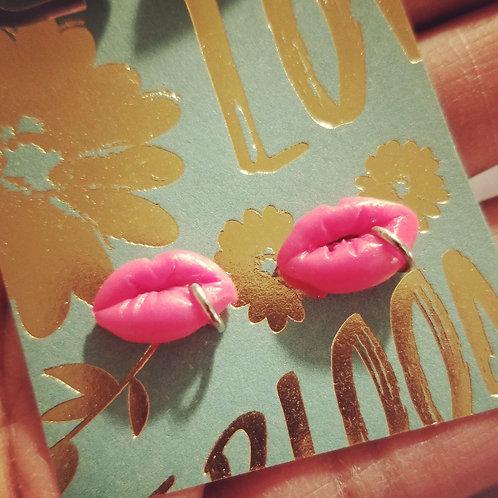 Pink pierced lip stud earrings