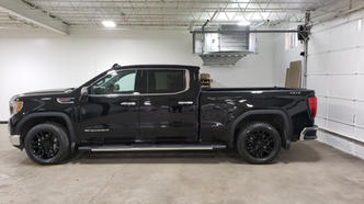 Pick up truck with black powder coated rims.
