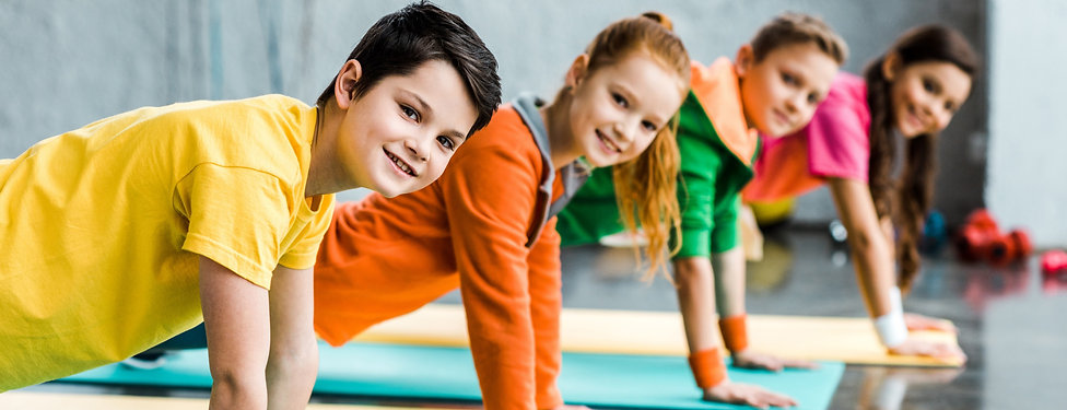 cheerful-kids-doing-plank-exercise-and-l