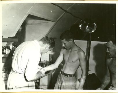 Doc. Hartford wielding his square needle