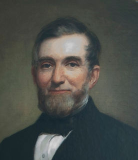 Ninian Wirt Edwards - painted portrait of a middle aged man with suit and bow tie, a close-cropped beard, small smile, and short hair combed to the side.