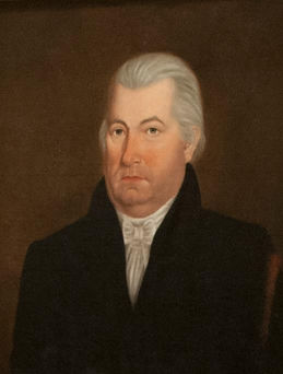 Governor Ninian Edwards - man in suit with bow-tied cravat, unsmiling with slicked-back hair.