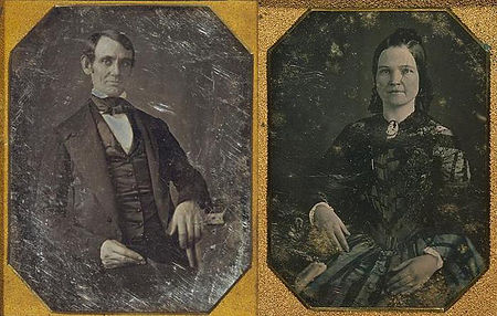 Side by side photos of young Abraham Lincoln in suit and bow tie and young May Todd in crepe and lace dress with curled hair.