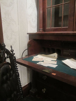 19th century desk with letters and writing materials