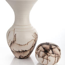 Horsehair embellished vase and globe