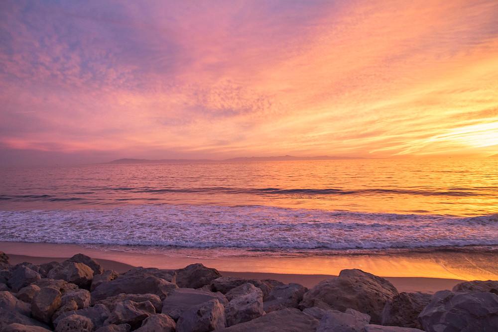 Rainbow sunset waves