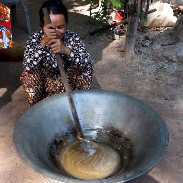 Woman making palm sugar