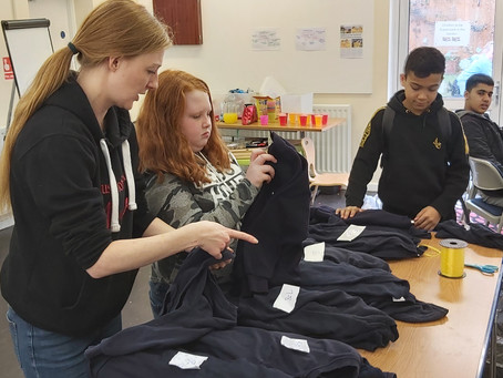 Young People at Kicsters volunteer their time to build Uniform Bank