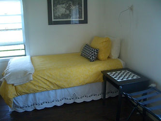 Yellow/white/black guest room