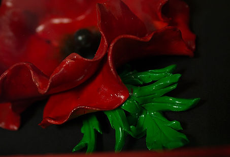 Original design polymer clay poppy, shown framed in a contemporary black box frame