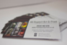 Stack of business card's designed and printed by All Aspect Art & Print, featuring all contact details and business information. A similar service is available for leaflets.