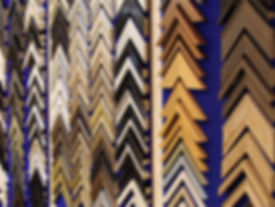 Picture framing, a range of mould styles and colours, display sample chevrons mounted on wall