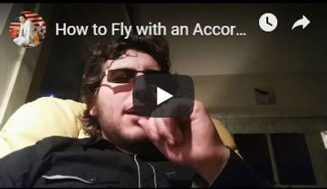 Cory - Flying With Accordion.JPG